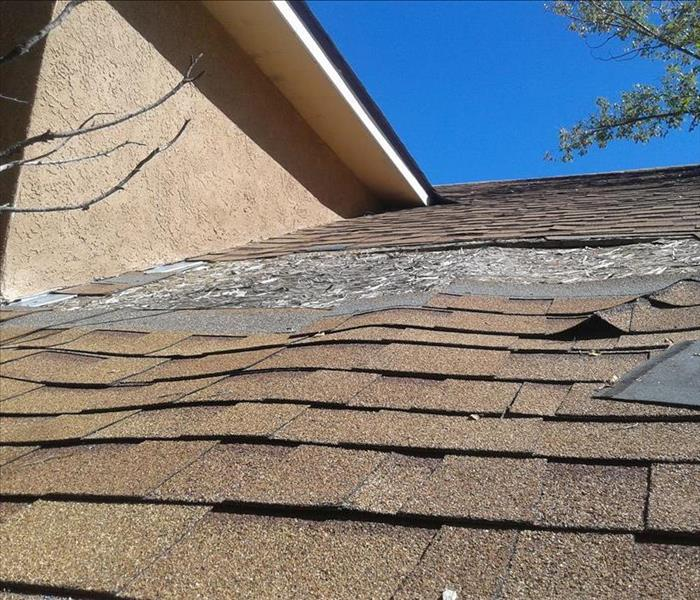Wind Damaged Roof in Rio Rancho Before