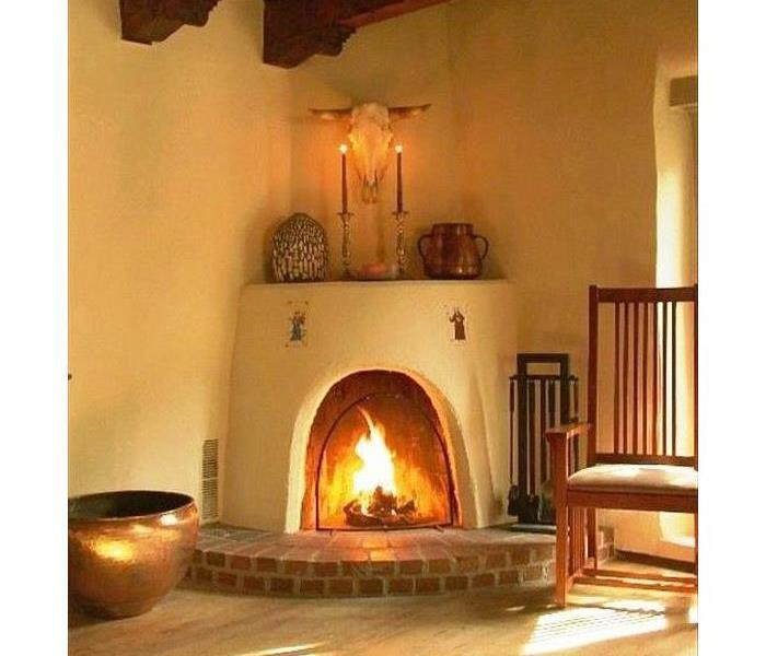 Adobe fireplace with a fire burning